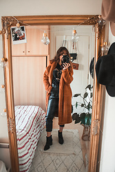 Theoni Argyropoulou - Teddy Bear Coat, Bershka Band T Shirt, Bershka Faux Leather Trousers, Bershka Ankle Boots - Styling the teddy bear coat on somethingvogue.com