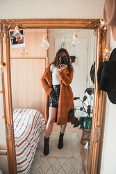Theoni Argyropoulou - Teddy Bear Coat, Zaful Ribbed Pullover, Pull & Bear Vinyl Skirt, Snakeprint Boots - Styling the teddy bear coat on somethingvogue.com