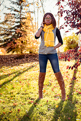 Louisa Moje - Yellow Blanket Scarf (Exact), Black Fitted Top (Exact), Quilted Vest (Exact), Blue Jeans (Similar), Over The Knee Boots (Exact) - How to Wear a Blanket Scarf