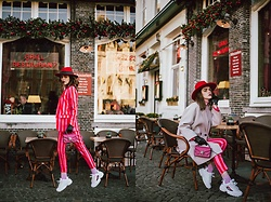 Andreea Birsan - Striped Blazer, Striped Trousers, White Sneakers, Mini Bag, Beige Oversized Coat, Red Hat - Pink suit