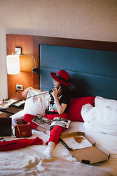 Andreea Birsan - Red Trousers, Graphic T Shirt, Red Fedora Hat, Red Bag, Cashmere Sweater - Hello room service, can I have another pizza?
