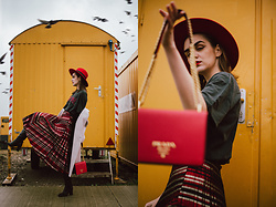 Andreea Birsan - Red Fedora Hat, Black Graphic T Shirt, Beige Oversized Coat, Shiny Pleated Midi Skirt, Knee High Black Boots, Red Bag - What to wear when you feel uninspired