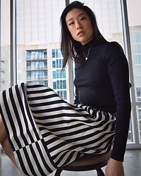 Gi Shieh - Mala Prayer Golden Necklace, H&M Black Turtleneck Crop, Topshop B+W Striped Skirt - Business Casual with an Edge