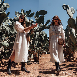 Jacky - Mango Dress, Black Palms Shop Old West Boots, Onvacayshop Ata Bag, Chimi Eyewear Sunglasses - Cowboy Boots combined with a white Midi Dress
