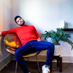 Emmanuel Martz - Topman Orange Sweater, Adidas White Sneakers, Zara Jeans - Gold Chair