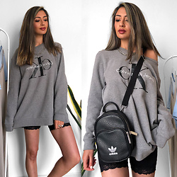 Heba E -  - Oversized Tops and Cycling Shorts