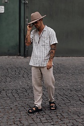 Kevin Elezaj - Tiger Of Sweden Sandals, Zara Pants, Farah Shirt, Ray Ban Glasses, Brixton Hat - Linen