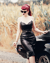 Charlotte S. - La Femme En Noir Serpentine Bustier Top, La Femme En Noir Serpentine Pencil Skirt, La Femme En Noir Vamp Batwing Cat Eye Sunglasses - Dressed To Kill