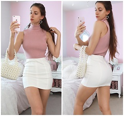 Tia Mcintosh - Pink Turtle Neck, Shop Akira Pearl Handbag, Shop Akira White Mini Skirt, Heart Pearl Earrings - Pearly & girly
