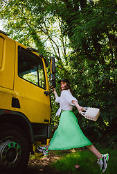 Andreea Birsan - Neon Green Pleated Midi Skirt, White Beaded Bag, White Shirt, Black Sequins Cap, Chunky Sneakers - Jumping in the new week