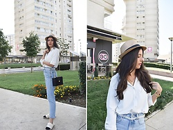 Jelena Dimić - Gift Shop In Thassos Hat, Femme Luxe Oversized White Shirt, Cosmic Chains Zodiac Necklace, Rosefield Watch, Shein Pearl Belt, Zara Straw Bag, Zara High Waist Light Wash Jeans, Shein Two Toned Espadrilles - Trying to move, but I'm stuck in my shoes