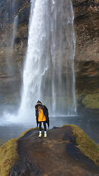 Ewa Michalik - Reserved Sweater, Reserved Coat, Saucony Orginals Polska Sneakers - Seljalandsfoss, Iceland