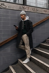 Kevin Elezaj - Converse Sneakers, Uniqlo Pants, Kith Sweater, Topman Coat, Nike Beanie - On the go