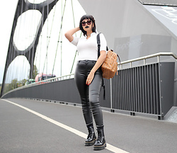 Gilda - Bershka White Crop Top, Mcm Backpack, Zara Leather Pants, Dr. Martens Black Leather Plateau Boots, Moschino Black Sunglasses - Dr Martens power