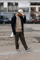 Kevin Elezaj - Vans Sneakers, Cos Pants, J. Crew Sweater, Topman Vest, The North Face Cap - December 9th