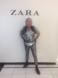 Hot One - Liquid Silver Short Sleeve Bodysuit, Forever 21 Shiny Silver Spandex Leggings., Shiny Silver Holographic Fanny Pack., Black Tennis Shoes, Various Neckwear Jewelry, Silver Lame' Cufflinks Or Gauntlets, Basic Black Socks - Just a ZARA moment for the ages!
