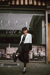 Andreea Birsan - Black Sequin Baseball Cap, Sunglasses, Two Tone Oversized Blazer, Black Maxi Dress, Lace Up Military Boots, White Beaded Bag - Two tone blazer