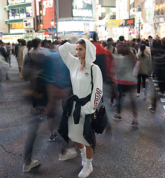 Adriana M. - Adidas White Hoodie, Nike Sneakers, Pretty Little Thing Pencil Skirt - Shibuya Crossing