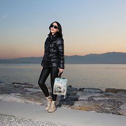Amy Grey - Calvin Klein Black Jacket, Dogo Printed Women Backpack, Dogo Printed Women Mid Calf Boot, Carrera Sunglasses - Travel Lover