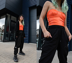 RuiJun L - Femme Luxe Finery Orange Corset Top, Puma Jogging Pants, Knock Off Balenciaga Triple S - ORANGE CORSET TOP