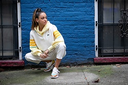 Lauren Recchia - Lacoste Knit Polo, Chloe Sneakers, Yellow Knit Hoodie, Faux Leather Pants - Sporty Chic