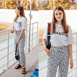 "Christina & Karina Vartanovy - Billie Eilish X Bershka Reflective T Shirt In White, Bershka ""Mickey Gets Arty"" Trousers, Bershka Crossbody Bag With Flame Print, Justfashionnow Sandals In Black - Karina // one more night"