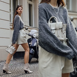 Jacky - Via Omoda Cowboy Boots, Copenhagen Muse Shorts, 3.1 Phillip Lim Small Bag, Arket Wool Sweater - Leather shorts combined with a cozy sweater