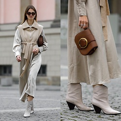Jacky - Lola Cruz Cowboy Boots, Polo Ralph Lauren Small Bag, Black Palms The Label Long Satin Dress, Holzweiler Knitted Vest, Bottega Veneta Cat Eye Sunglasses - Midi dress combined with knitted vest