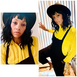 Jasmine Wilson - H&M Black Hat, Yellow Silk Blouse, Black Overalls - Mellow Yellow