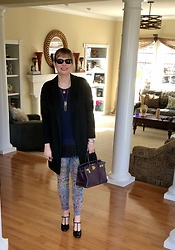 Shannon D - Piazza Sempione Black Cashmere Coat, Manolo Blahnik Heels, Oliver Peoples Sunglasses, Hermès Bag, Elisabeth Bell Jewelry Heart Necklace - Paint Splattered Jeans