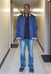 Thomas G - Levi's Varsity Bomber Jacket, Claiborne Polo, American Eagle Outfitters Artist Flare, Skechers Sketch Knit - Varsity bomber jacket | Flare jeans
