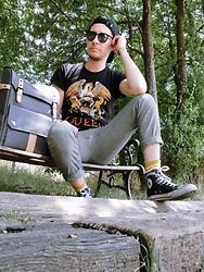 Dillon Magill - Converse Black Chucks, Vinta Backpack, H&M Hounds Tooth Plaid Trousers, Target Queen Band Shirt, Studebaker Metals Silver Id Cuff - Good old fashion lover boy