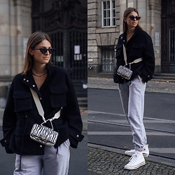 Jacky - Converse White Sneaker, Onweekends Grey Sweatpants, Weat Animal Print Bag, Meotine Black Jacket, Saint Laurent Cateye Sunglasses - Grey onweekends jogger combined with a black jacket