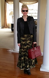Shannon D - Oliver Peoples Sunglasses, Acne Studios Black Leather Jacket, Barney'S Ny Black Cashmere Sweater, Hermès Bag, Prada Black Boots - Camouflage Maxi Skirt