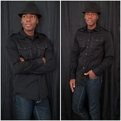 Thomas G -  - Fedora | Button down shirt | Jeans